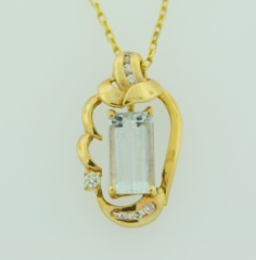 Aquamarine and Diamond Pendant, Set in 14k Yellow Gold