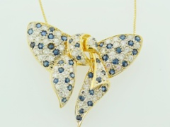 Sapphire and Diamond Bow Pendant, Set in 18k Yellow Gold