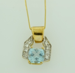 Cushion-cut Aquamarine Pendant with Diamonds in 14k Yellow Gold